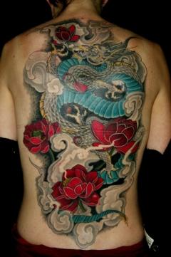 Feminine dragon full back tattoo