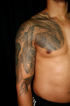 Greywash phoenix cover up tattoo