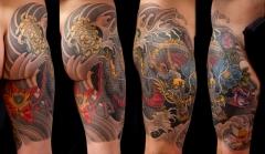 Dragon and lotus thigh piece tattoo
