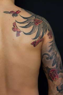A current work in progress - hawk chest piece and sleeve tattoo